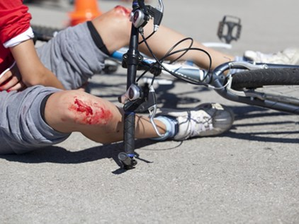 cyclist hit by car door