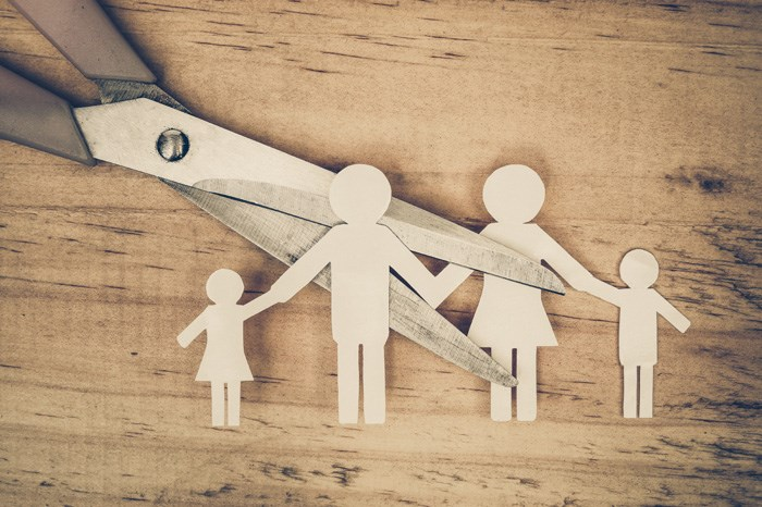 paper family with scissors cutting through